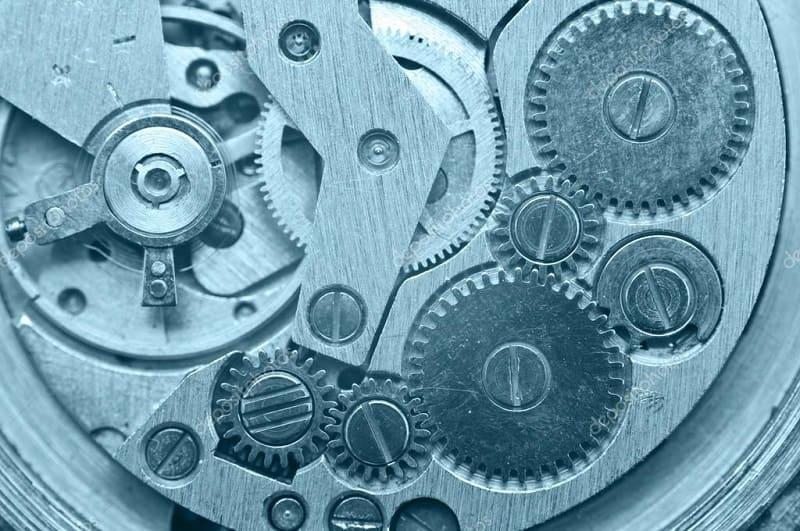 Зубчатые шестерни в механизме часов